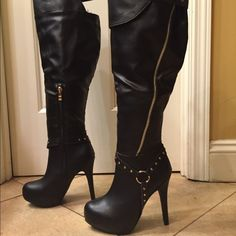 Sandrine NWT boots size 6.5 NWT over the knee boots have snap detail at knee and hardware detail at ankle Boots have a 5 in heel Size 6.5 tag attached Sandrine Shoes Over the Knee Boots