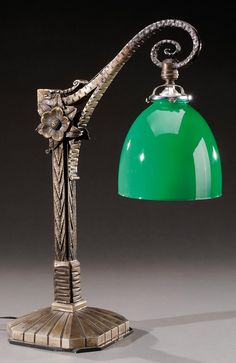 CHARLES PIGUET, attribution, octagonal, wrought iron floral desk lamp with cast base. Circa 1930. H : 19 in.