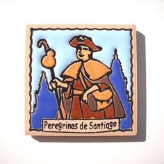(http://www.spanishdoor.com/camino-de-santiago-women-pilgrim-tile-way-of-st-james-fridge-magnet-peregrina/)