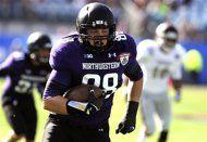 Northwestern ends drought in Gator Bowl. (AP Photo/Stephen Morton)