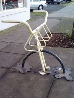 Bike rack outside a bike shop.