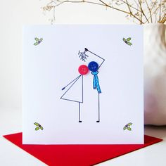 """A quirky and romantic card to send to your other half at Christmas, an engaged couple or a married couple.The card is available with no message on the front or with the options """"To my wife at Christmas"""", """"To my husband at Christmas"""", """"To my girlfriend at Christmas"""" or """"To my boyfriend at Christmas"""" above the couple. The card is blank inside for your own personal message.Christmas is about kissing under the mistletoe right? Get your other half to pucker ..."""