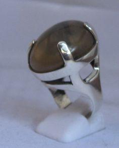 Anillo de ambar y plata