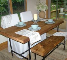Reclaimed wood table with industrial pipe legs