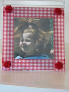 """This DIY """"photo frame"""" is actually a CD case with ribbon. An easy and sweet Mother's Day craft!"""