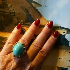 Vintage  statement turquoise claw ring A ring that dates I believe from the 70's or 80's and is from my collection. I wear a 7 and it fits me perfectly. There is a sizing ring inside but I do not believe this one can be made a lot bigger. Some tarnishing on band as shown in pic. Faux turquoise. Not marked. Vintage Jewelry Rings
