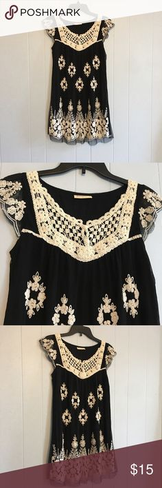 Black and cream Fashion Spy Embroidered dress Black and cream Embroidered dress. Has mess overlay over black slip. Material tag is missing. Length is appx 33 inches and armpit to armpit is appx 16 inches. fashion spy Dresses