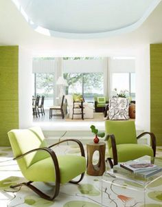 By designer Christina Murphy. This Oyster Bay New York beach house has a hand-painted, lily-pad pattern, covering the sunken floor. Love the pair of Prague Bent Wood armchairs designed by Jindrich Halabala, 1930s. Fine examples of Art Deco design