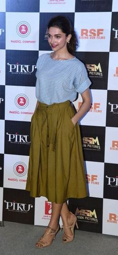 Deepika Padukone Deepika definitely knows how to beat the heat. At one of her Piku outings, she kept it simple and stylish in an olive green skirt, which she teamed with a striped tee. Nude sandals and bright red lips accompanied her summer style!