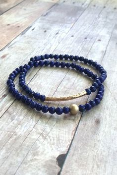 These natural stone stretch bracelets feature genuine lapis lazuli stones. The cobalt blue beads have some subtle natural gold flecks. I added one 14 K gold fil