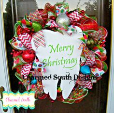 Customized deco mesh wreath made for a dentist.  ruffled deco mesh, ornaments, and ribbon.  Follow us on www.facebook.com/charmedsouth