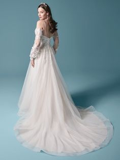The stylish cold shoulder bishop sleeve princess wedding dress for the modern bride made by Maggie Sottero. Find your one-of-a-kind bridal gown today! Colored Wedding Dresses, Dream Wedding Dresses, Bridal Dresses, Wedding Gowns, Bridal Gown, Tulle Wedding, Mermaid Wedding, Wedding Bride, Champagne Gown
