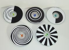 CD & Marble Spinning Tops by judy_jowers, via Flickr