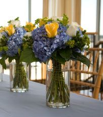 Blue - center piece ideas. The look can be recreated using artificial florals carried in Dollar Tree.