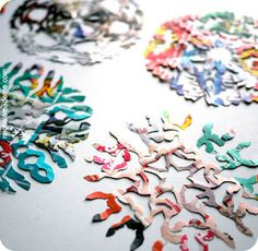 How to cut out snowflakes.  Could use old flyers that come in the newspaper...they provide a nice colour option!