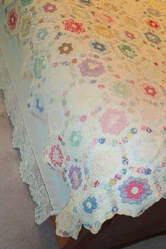 """Beautiful Vintage Quilt--It's covered in """"gons"""" but u have to admit that this is beautiful. The color saturation makes my heart skip."""