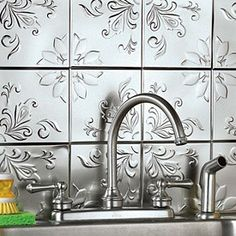 #cultivateit metal decorative backsplash behind the sink is darling. Attractive yet sanitary and easy to clean