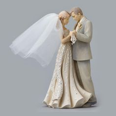 """""""The years have flown and now my little girl is a bride."""" Frozen in time is this moment when a father gazes in wonder that his little girl is now a bride. Beautiful cream color figure has a flowing go"""