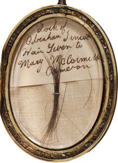 mourning locket containing a snip of Abraham Lincoln's hair