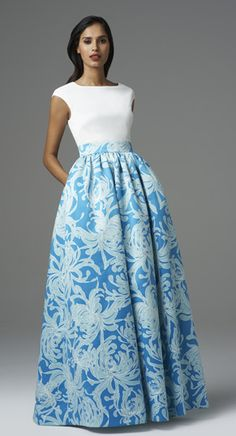 """<div class=""""ip-description""""><br/> Style#: 457800<br/> Colors: Ivory/Sky Blue<br/> Description: Printed Satin Gown w/ Cap Sleeve Bodice<br/> </div>"""