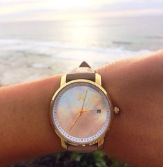 MVMT watch. Gold, pearl, leather.
