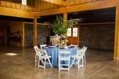 Stone walls and exposed beams make up the interior of our barn!  Picture credit: Megan Hobbs Photography