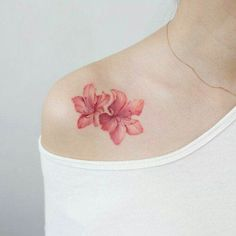 Stunning pink blossoms by Tattooist Charming And Irresistible Rib Tattoos Sexy and Charming Shoulder Tattoo Designs for Charming Book Tattoo Designs Ideas For Bookworms Trendy Tattoos, Unique Tattoos, Small Tattoos, Small Lily Tattoo, Elegant Tattoos, Popular Tattoos, Wildflowers Tattoo, Tattoo Flowers, Butterfly Tattoos