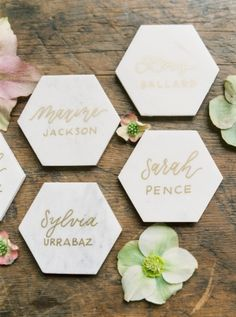 Gold calligraphy placecards on marble tile! Modern calligraphy in gold ink for guest seating cards. -j.rocro arts + letters   photo: Michelle Boyd  A Fresh Take on An Industrial Wedding With Serious Pops of Color Gallery - Style Me Pretty