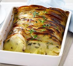 Crispy layered thyme potatoes: thinly slice then oven bake your spuds for an impressive side dish to serve with your Easter roast or Sunday lunch