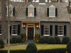 Love the dark gray paint with dark shutters. Beautiful!