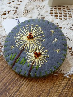 Items similar to ES536/040 -  Dandelion inspired handmade felt brooch - Grey on Etsy. , via Etsy.