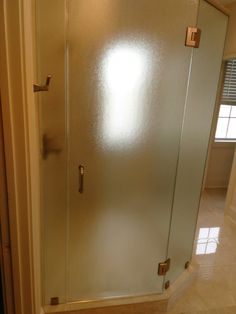 "308 City Club 3/8"" textured monolithic tempered glass master shower enclosure with brushed nickel hardware"