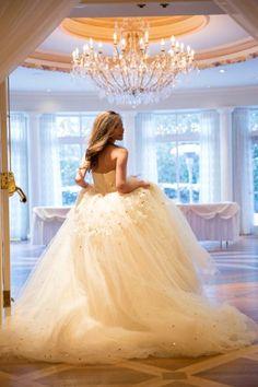 So glamorous! White bridal ballgown with flecks of gold all over #wedding #gold #bride #ballgown #blacktie