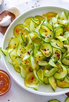 Asian Cucumber Salad If you love Cucumber and Asian flavors, this will be your favorite salad. Simple, easy yet bold pack-a-punch sweet-sour flavor.. It always makes a statement when I serve it to my guests. #cucumber #salad #lowcarb #glutenfree #lowcarbrecipes #plantbaseddiet #healthyrecipes
