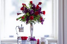 red purple wedding flowers | Purple-red-wedding-flower-centerpieces-silver-vase.original