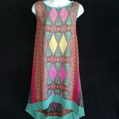 "LOVE 21 Stain Glass Shift Dress Runs Large XS LOVE 21 Stain Glass Shift Dress Hi Lo, Keyhole Back, Runs Large XS, Lined  Approximate Measurements  Chest 34 Waist 40"" Hips Free Length at Longest Point 40"" love 21 Dresses High Low"