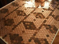 Backsplash+Made+of+Pennies | Here we have our pennies in place and we are pouring the epoxy