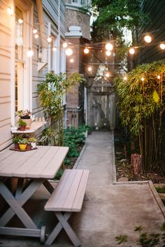 Garden and Patio, Beautiful Small And Narrow Side Yard House Design With Hanging Lamp Concrete Footpath With Small Garden And Bamboo Plants Plus Vintage Wooden Table With Desk Ideas ~ Side Yard Ideas