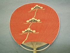 uchiwa: flat, non-folding japanese fan with printed patterns on silk or paper stretched over a bamboo frame.
