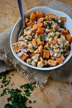 For the salad:  2 pounds sweet potatoes (about 3), peeled and cut into 1 inch cubes  2 tablespoons extra-virgin olive oil  1 15-ounce can chickpeas, drained and rinsed  ¼ of a medium red onion, finely chopped  ½ cup chopped fresh parsley     For the dressing:     1 medium garlic clove  ¼ cup freshly squeezed lemon juice  3 tablespoons well-stirred tahini  3 tablespoons water  2 tablespoons extra-virgin olive oil  1 tablespoon miso paste (optional)  salt and pepper to taste