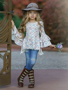 Ruffled boho-chic sleeves will make her feel like the little fashionista she is in this trendy pom pom tunic. Pair it with any bottom for a precious, put-together look!  Hand wash cold; hang dry Imported Little Girl Models, Little Girl Outfits, Kids Outfits, Baby Girl Fashion, Kids Fashion, Dress Up Shoes, Kids Dress Wear, Girl Bottoms, Little Fashionista