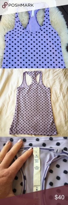Lululemon Racerback Tank Happy Purple Polka Dots This is in as-new condition. I bought it new and wore it 1x, gently washed and air dried flat (of course). There is no pilling or other signs of wear. I have another Lululemon tank which I wore more often, so if you need a suble, cute and playful boost to your yoga wear, this is for you! lululemon athletica Tops Tank Tops