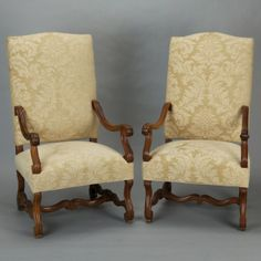 Pair Large French Carved Armchairs --- Pair of circa 1920s large French armchairs have curvy scrolled arms, legs and stretchers. Newly upholstered in a neutral ivory and beige chenille jacquard. Sold and priced as a pair. --- Item: 405 --- Retail Price: $3495