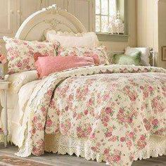 Like the headboard and the cabbage rose quilt.