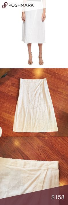 "nwot eileen fisher white linen A-line wrap skirt this is an eileen fisher organic linen A line skirt in white. 100% organic linen. it has a wrap look to it. this would be the perfect summer look — especially for a beach! the front waist is not stretchable, but the back is. it is a size small.  approx. measurements: waist: 31.5"" length: 29""  i do not trade but please make me an offer via the offer button 🙂  *model photo shown as an example only* Eileen Fisher Skirts A-Line or Full"