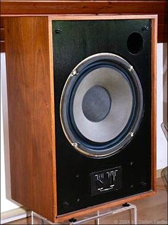 Tannoy speakers like this one are coaxials, a tweeter is mounted underneath the acoustically-transparent dustcap dome; it's actually a grille for the tweeter. Tannoys were known for vivid, pinpoint stereo imaging because of their point source design. Some avoided coaxial speakers like Tannoy because they equated the design with mediocre coaxial car speakers. They missed out on great sound!