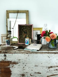i love the personality that shines through from layering framed art and from leaving trinkets exposed on a counter!