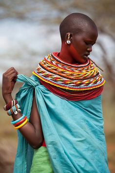 """""""Samburu women are always adorned in a dazzling display of fabrics  and colourful beads. These beads are not just for beautification, they usually have a story to tell about whether a woman is engaged, being courted, or married. When a young woman is being courted by a man, he gives her a bright collar of colourful beads to show that she is his girlfriend. Once married to the man she has been promised too, she must give these beads back and wear different jewellery to indicate her new…"""