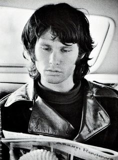Jim Morrison reading album reviews in the back of a car.