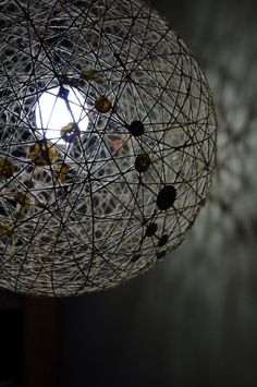 Jute Rustic Hanging Sphere Lamp with Buttons by IvyStyles on Etsy, $70.00. I could make this for way less!